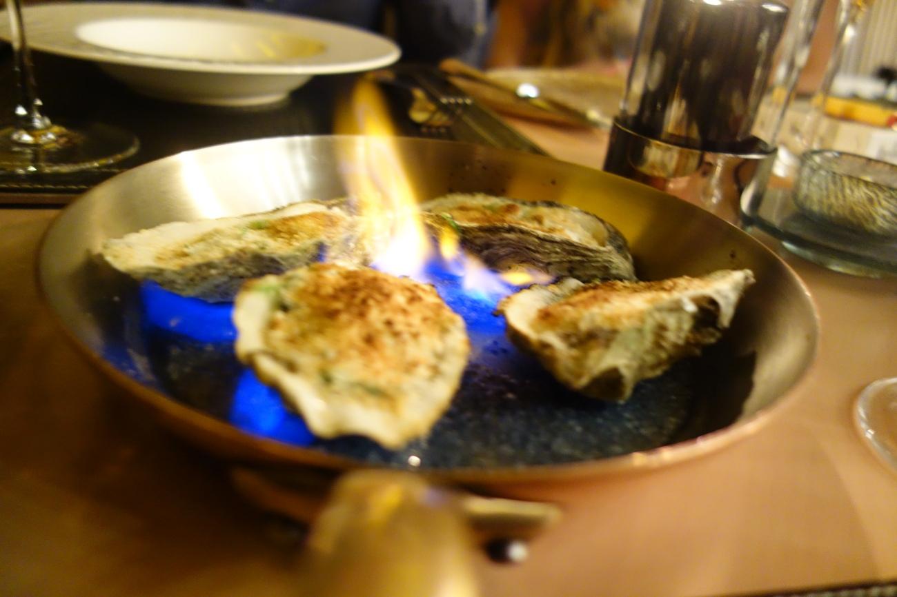 Flaming oysters Rockafeller at St Regis Doha