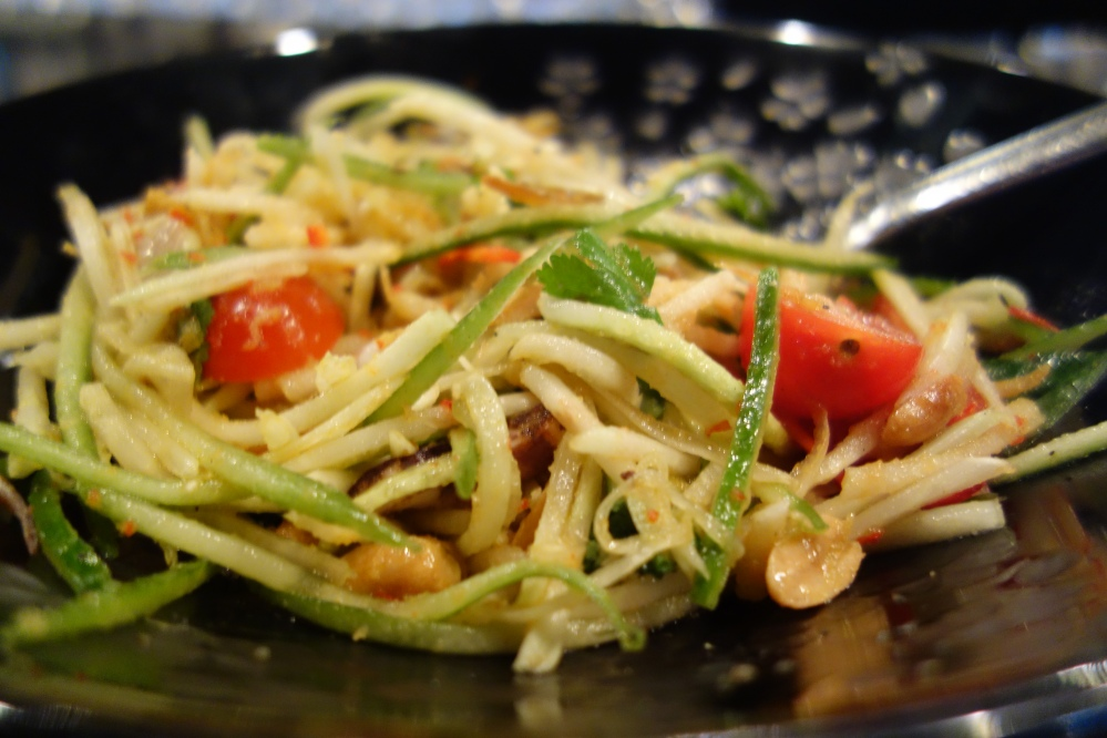 Calamari, green papaya and cucumber  salad, with nahm jim, peanuts and crispy anchovies
