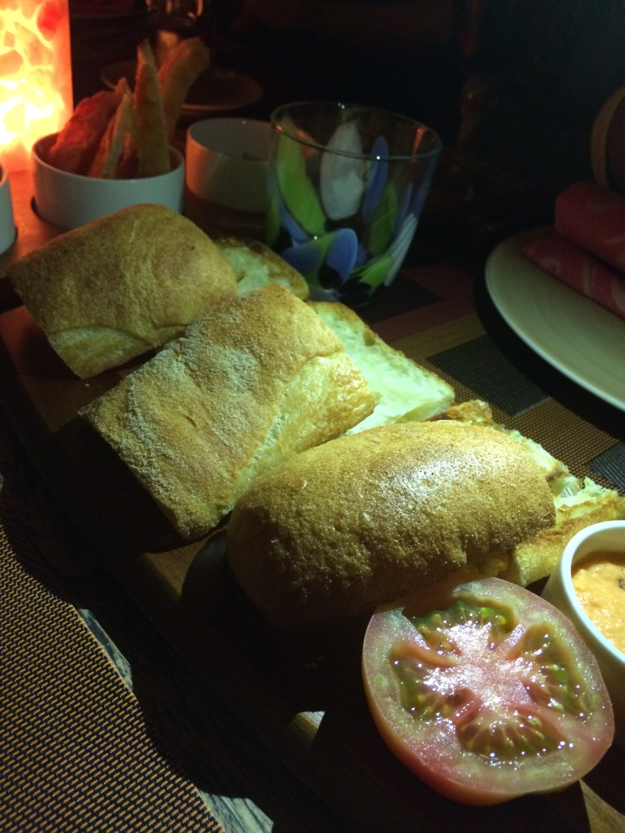 Traditional Spanish bread. You smash the tomato into the bread. You won't eat bread the same way again!