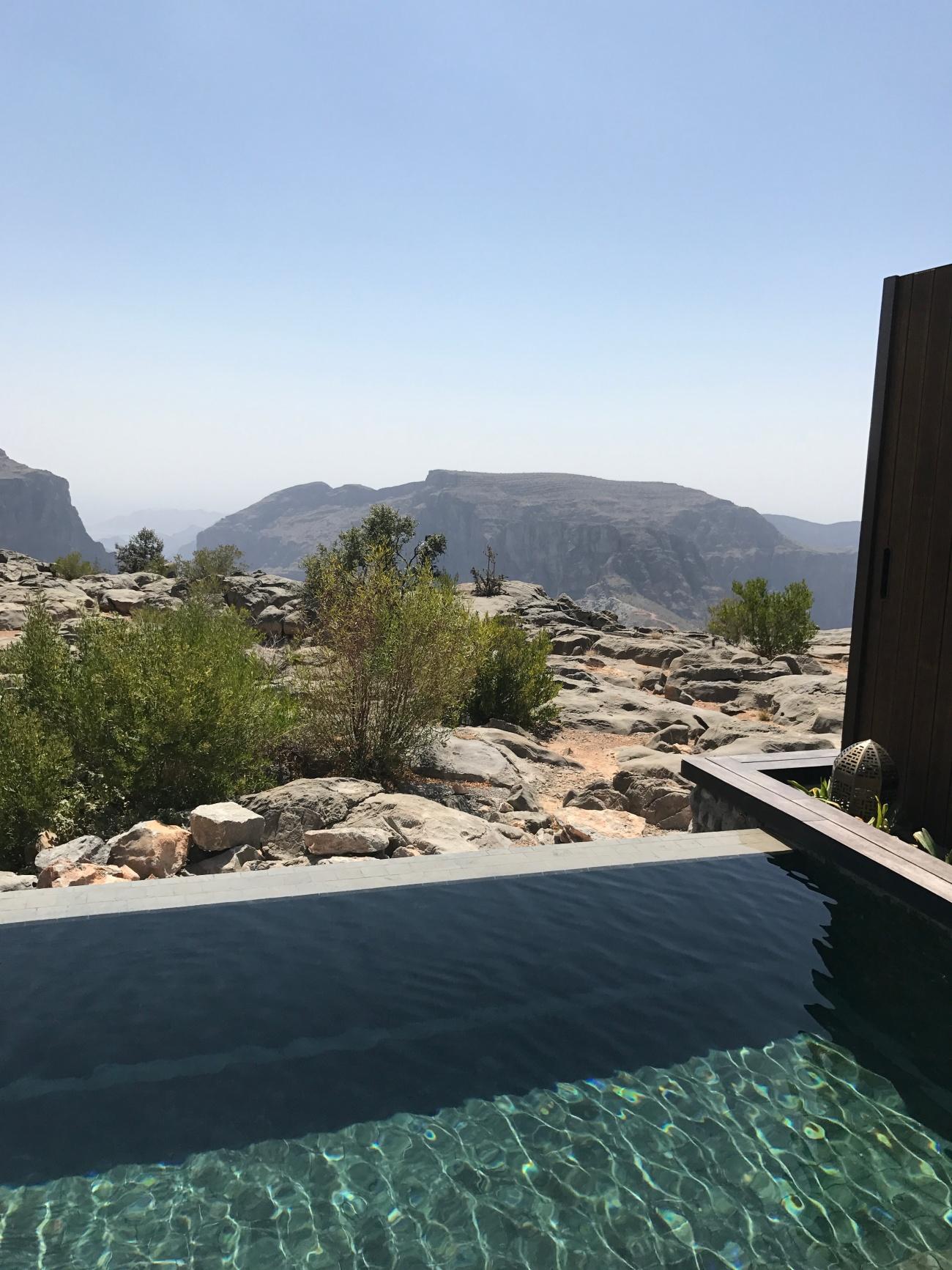Oman view villa pool travel blogger